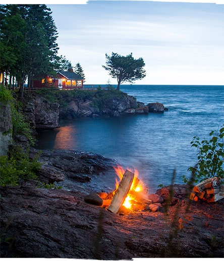 Breezy Point in the evening with a campfire