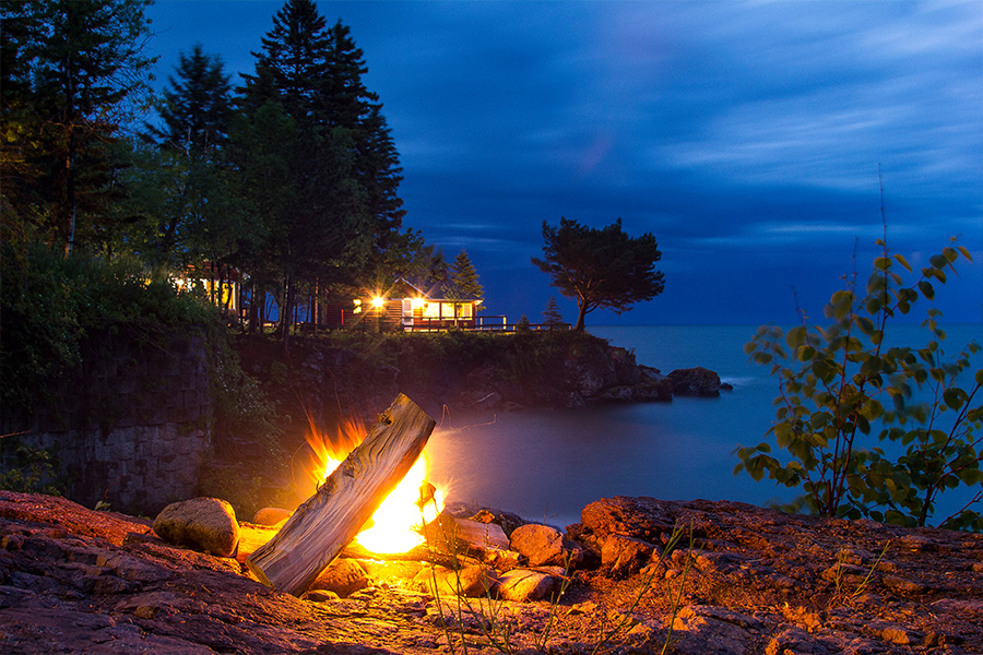 Campfire overlooking a cabin at Breezy Point Cabins on Lake Superior